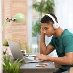 Student on laptop wearing headset
