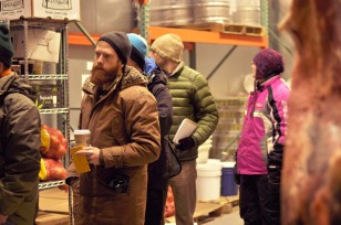 UVM students tour one of the freezers at the Mad River Food Hub.