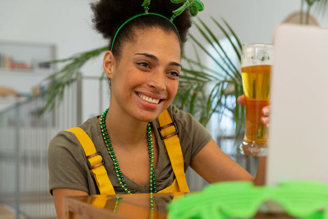 Woman celebrating St. Patrick's Day with friends online