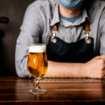 Craft brewer beer on bar man with mask