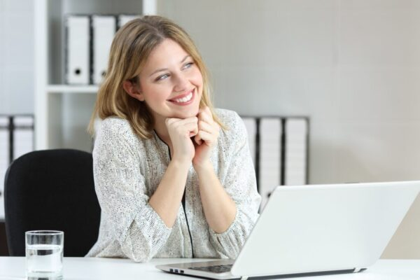 Female professional working at her desk with a laptop