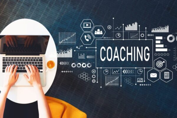 Coaching with person using a laptop on a white table