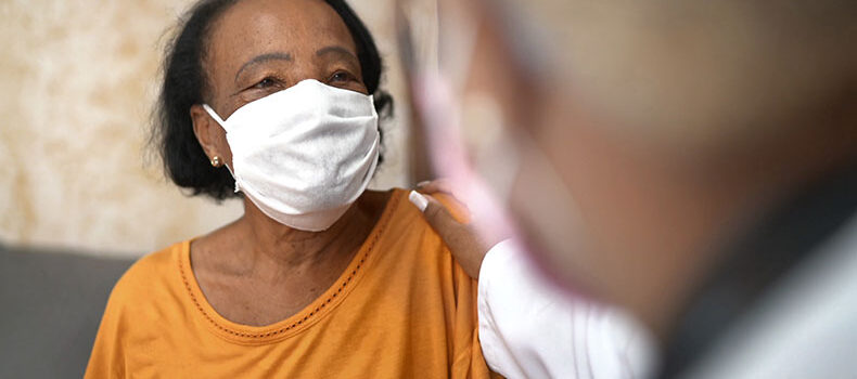 Woman wearing a face mask receiving care