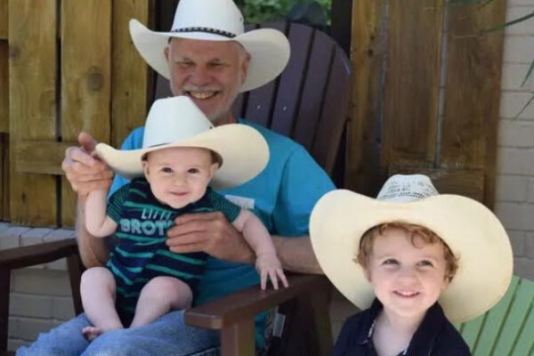 JamesBrent with young children wearing cowboy hats