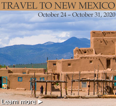 New Mexico trip image with an adobe house with mountains in the background