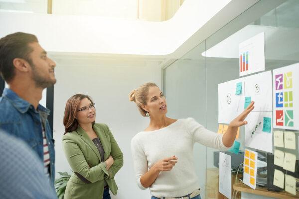 People in an office talking