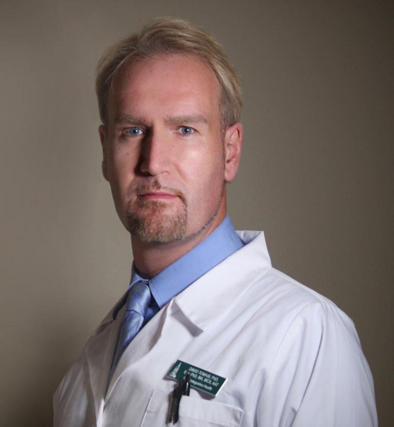 Dr. David Låg Tomasi