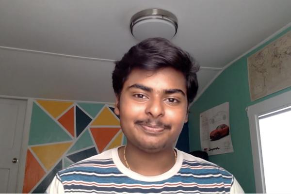 Jeswin Antony wearing a striped shirt