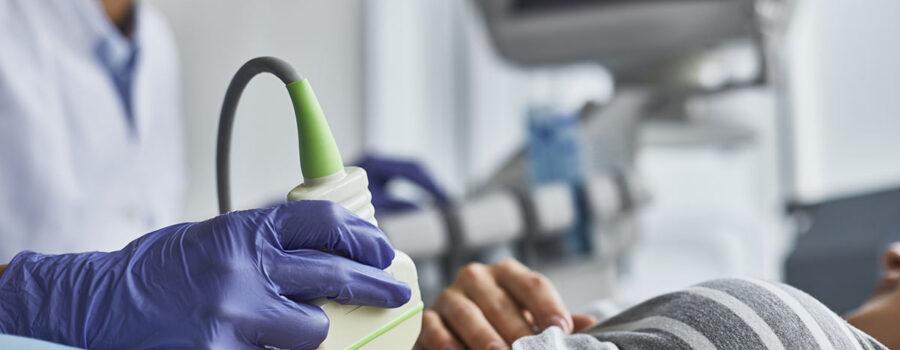 Nurse administering an ultrasound wearing gloves