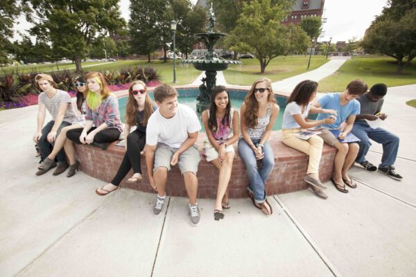Students gathered on a fountain