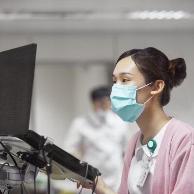 Nurse using laptop while making medical record