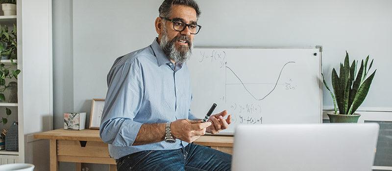 Man sitting using a laptop
