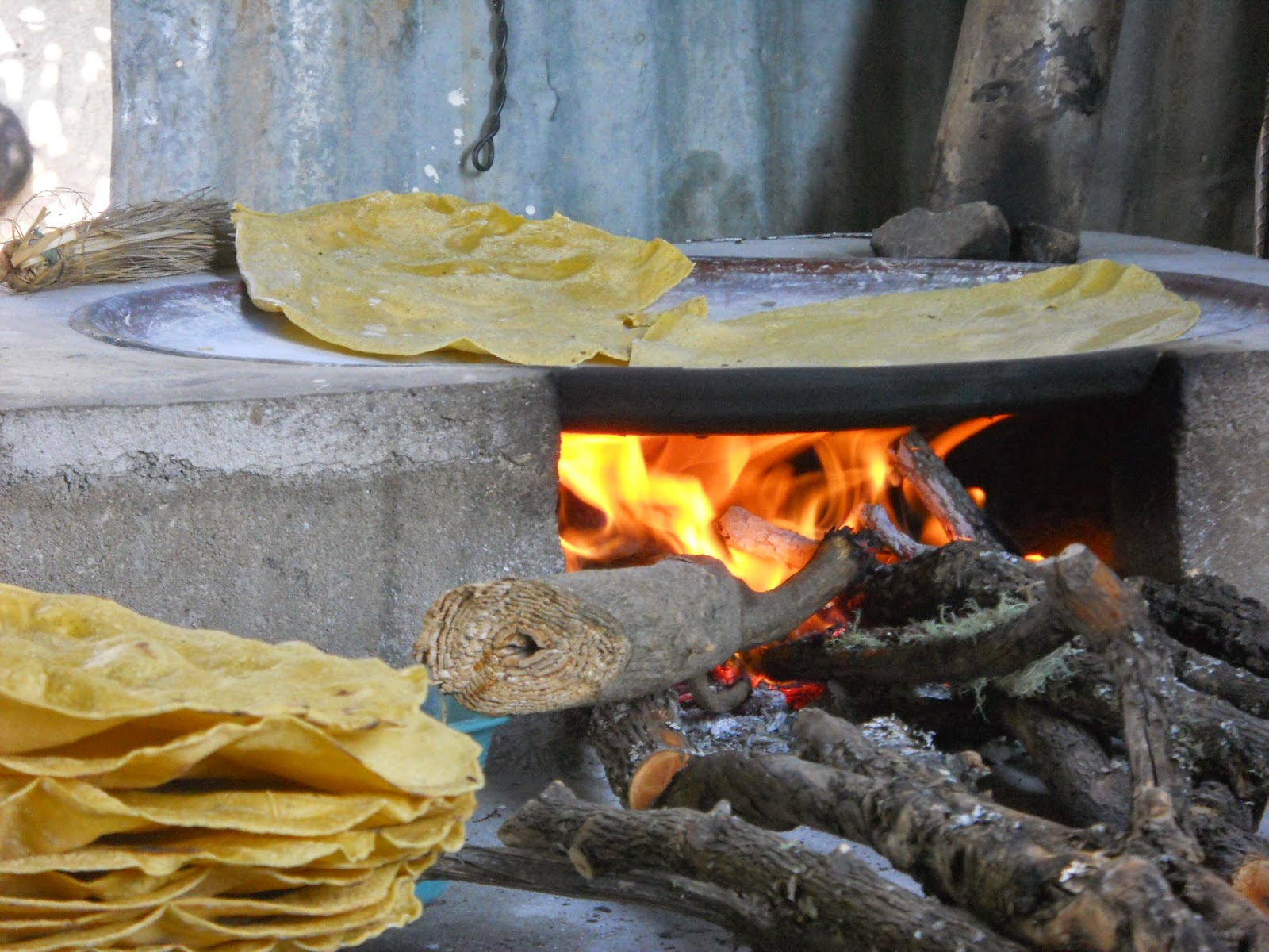 Tortillas being cooked on an open fire