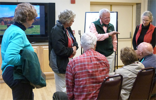 "Dr. Robert Hamill, center, continues discussing points with interested OLLI members after his engaging program ""The Brain: How Does It Work Anyway?"""