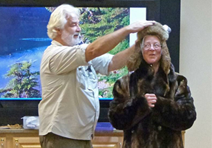 "Naturalist Kurt Valenta adds beaver ""adaptations"" to Springfield OLLI member, Marjory Pierce, to demonstrate the many special structures that a beaver has to be considered ""Nature's Superb Engineer."""