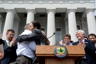 Sen. David Zuckerman embraces Senate President John Campbell before the signing of the bill in May. Photo by Angela Evancie, VPR